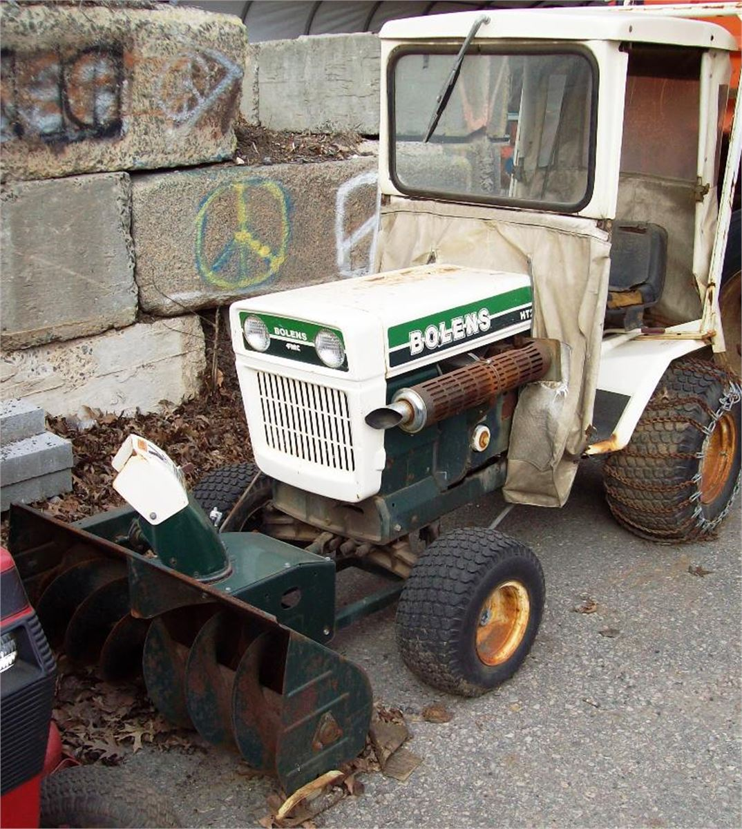 BOLENS MODEL# HT23 TRACTOR WITH SNOW THROWER ATTACHMENT